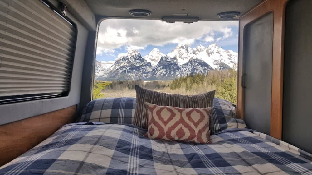 Back door of a Sportsmobile Sprinter van open to see the Grand Tetons