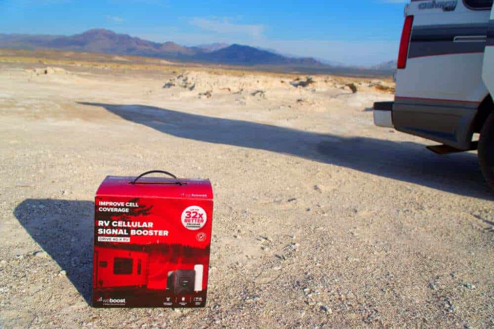 WeBoost Cellular Signal Booster in the desert near a van