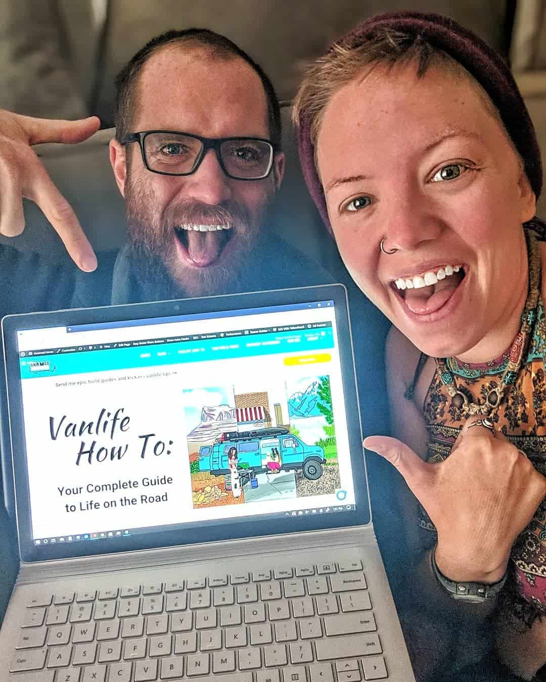 Jayme and John post in their van by their computer, where they educate people about van life