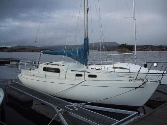 The Albin Vega 27 small bluewater sailboat in a marina