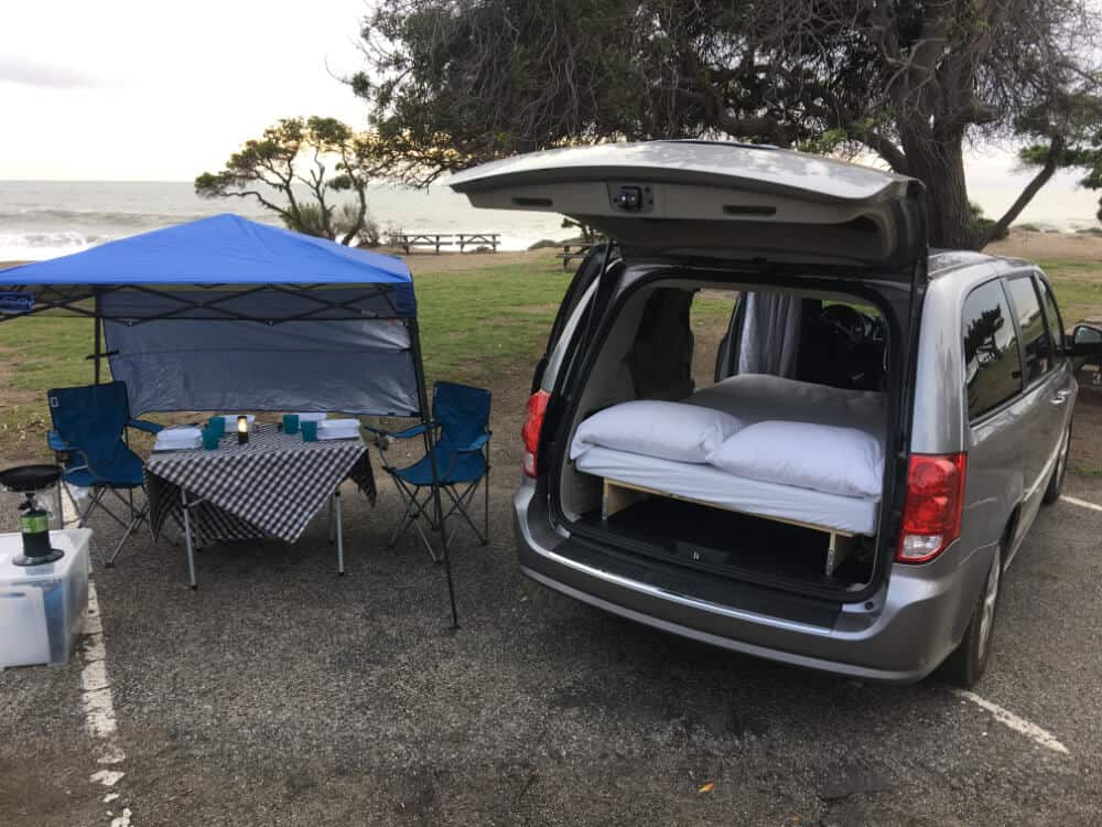 Dodge caravan camper with hatch open on the beach