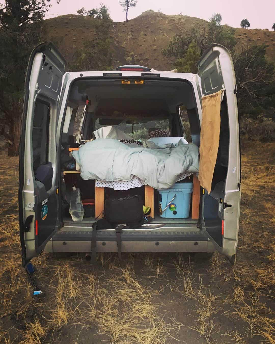 Back doors open to show interior of Ford Transit Camper