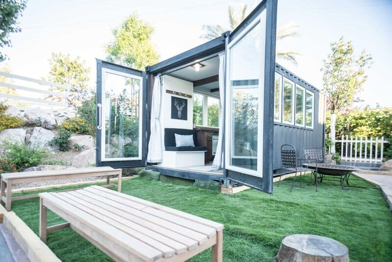 Two French Doors open on the end of a shipping container home