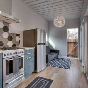 Interior kitchen view of a shipping container home
