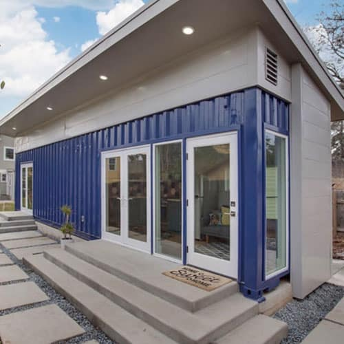 A bright blue shipping container home by Taynr