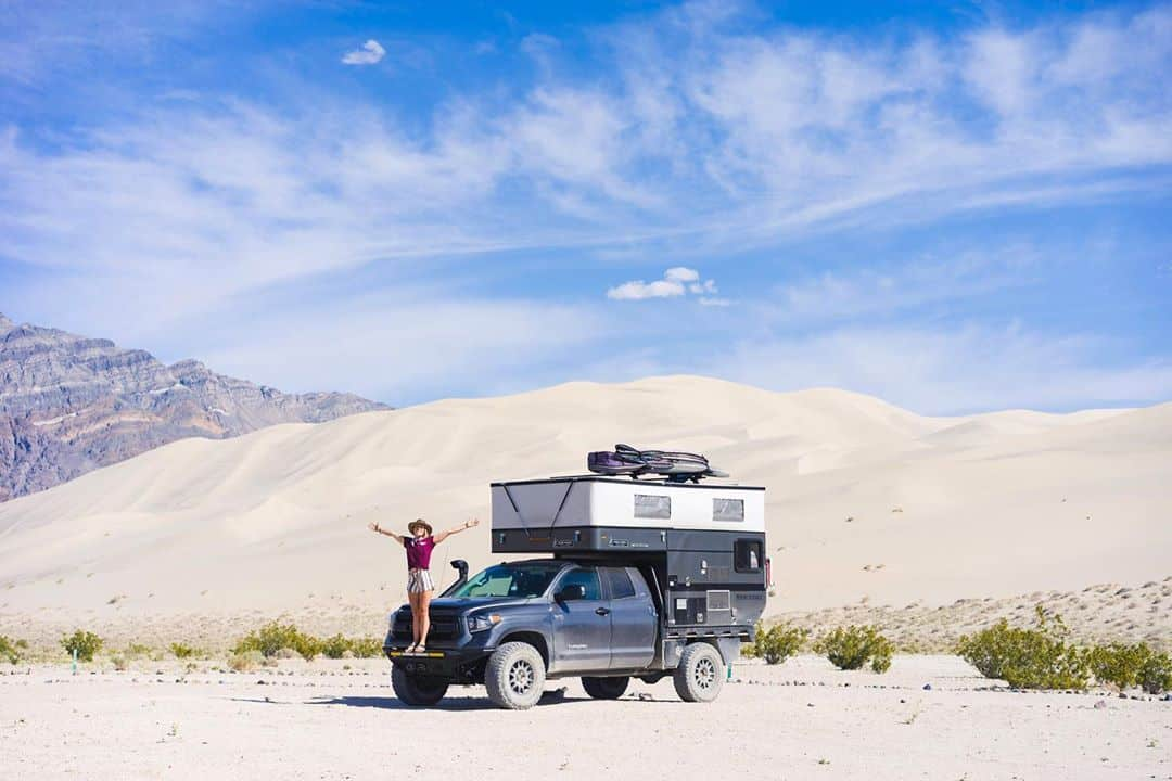 Mak and Owen's four wheel pop up truck camper in the desert