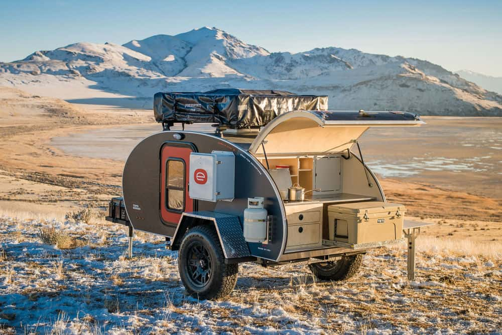 Escapod Topo Series Off-road Camper parked on a hilly, snowy mountain