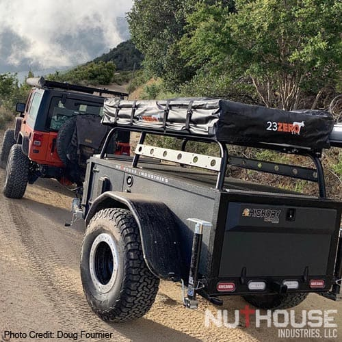 Jeep towing a Hickory Expedition off-road trailer