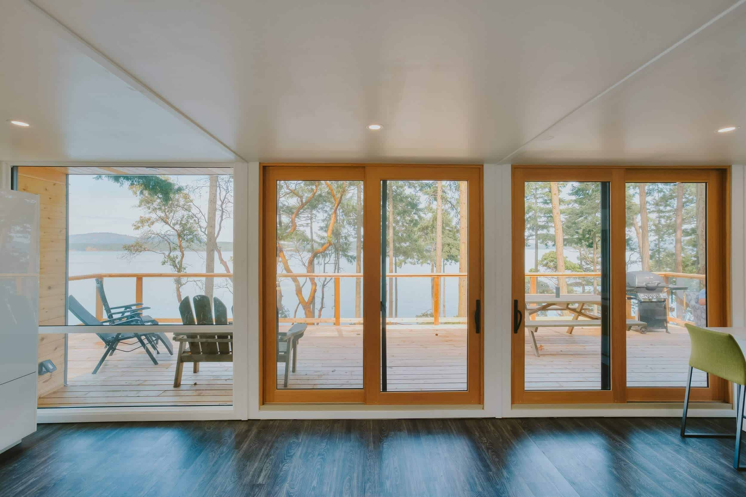 Large windows looking out onto the deck in this container home