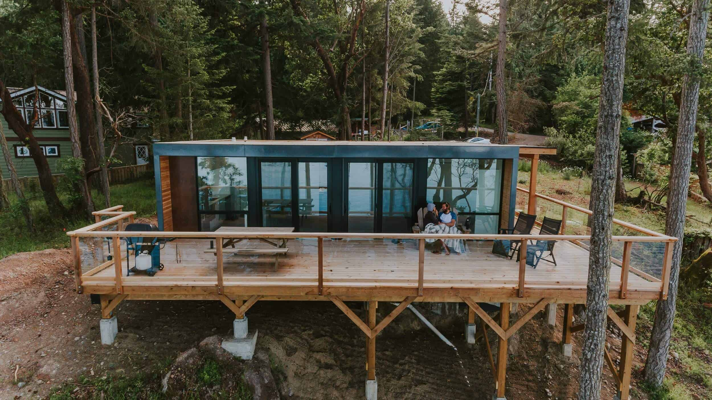 Shipping Container home perched on a forested hill
