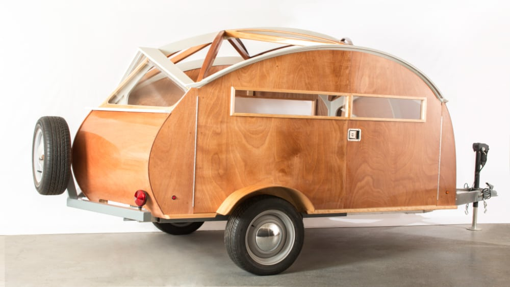 The Hutte Hut teardrop camper is made of wood and is gorgeous