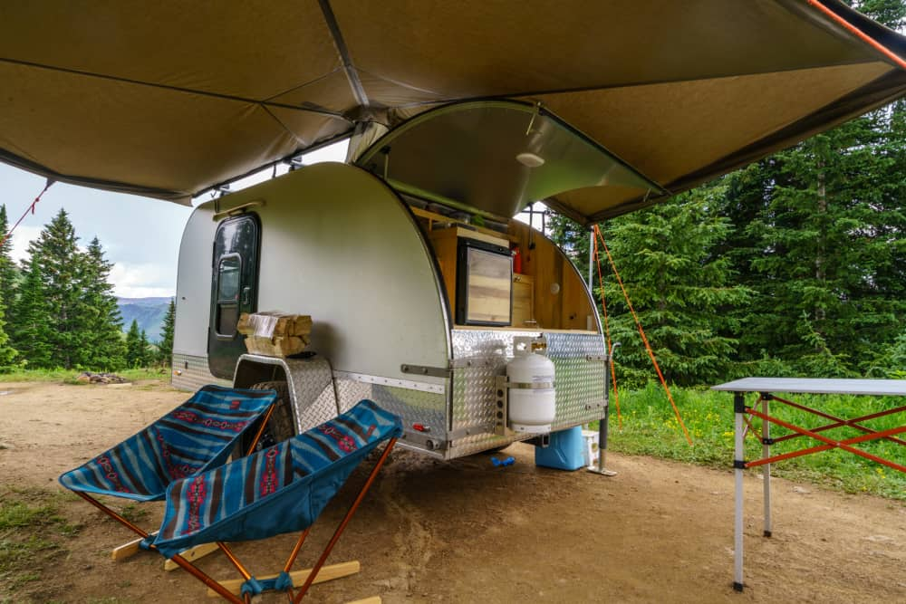 The Mount Massive Teardrop camper parked under an awning