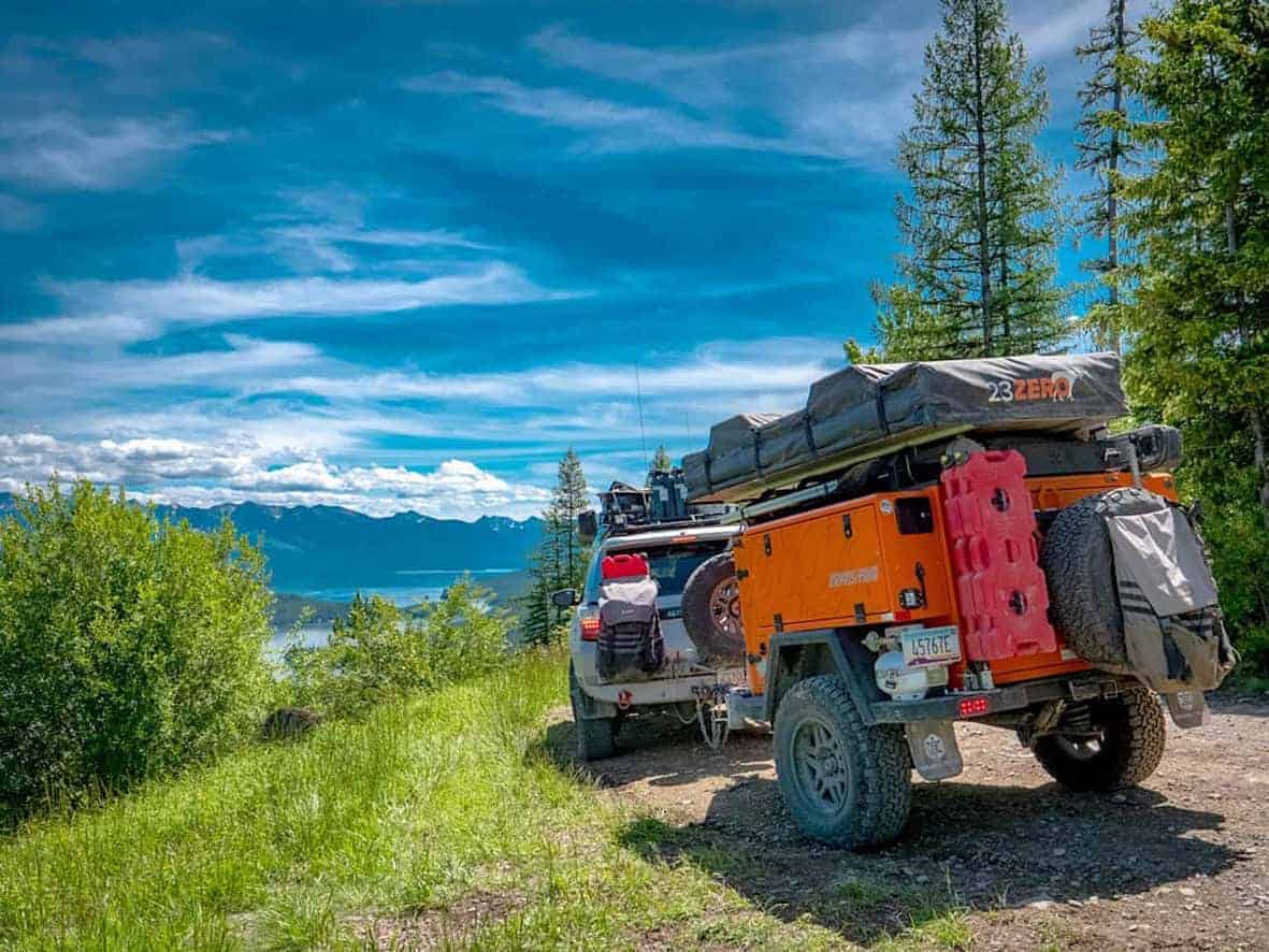 Turtleback Expedition off-road travel trailer on a bumpy dirt road in the mountains.