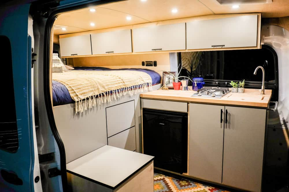 Interior of the Vincent Van Go Ford Transit van with bed and kitchen