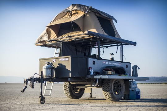 XV-2 off-road camper trailer with rooftop tent extended parked in the desert