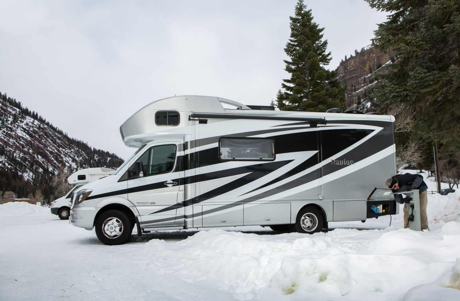 Winnebago Navion small RV parked in the snow