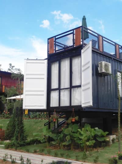 Two shipping container homes parked on a hill