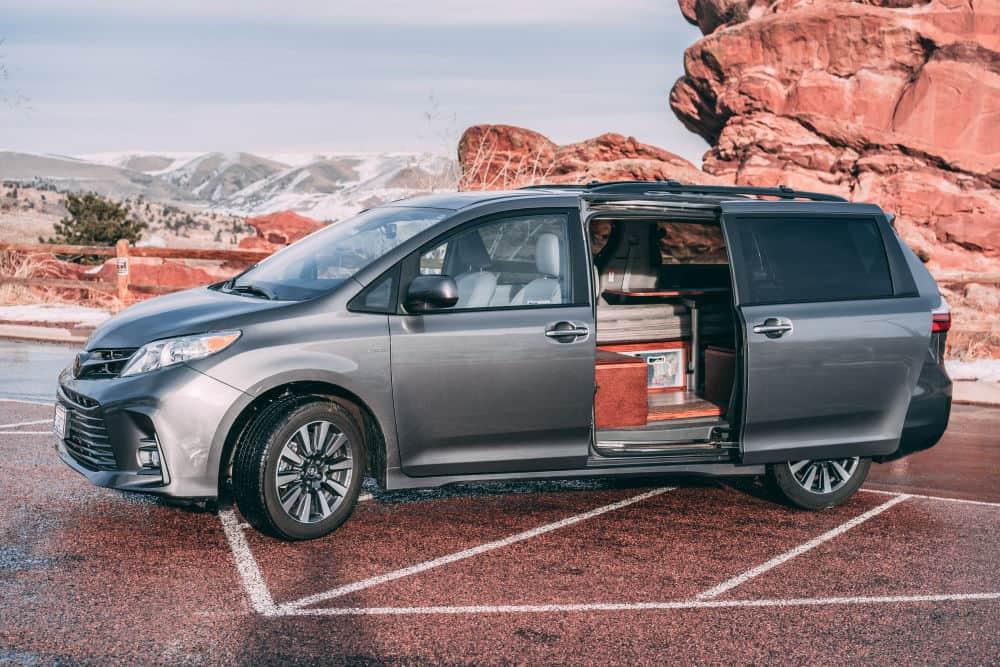Toyota Sienna 4x4 minivan camper parked with red rocks
