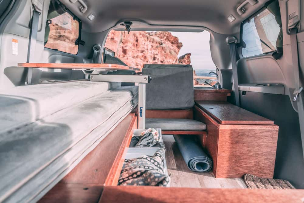 The interior of the Toyota Sienna AWD camper van conversion by Oasis