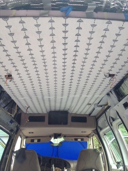 The long stripes and bright white of our DIY camper's ceiling helped open up the space and kept it from feeling cramped.
