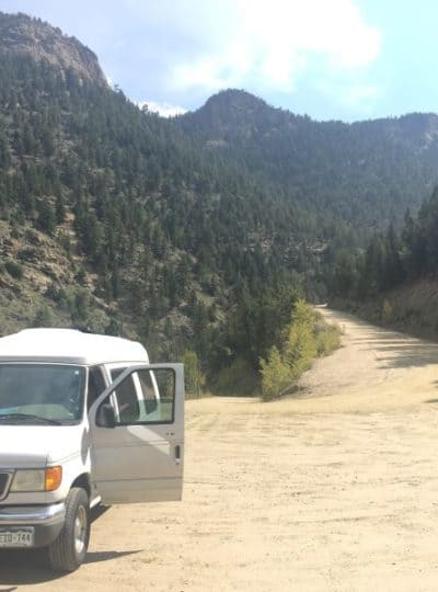 Ford Econoline DIY camper parked on a dirt road