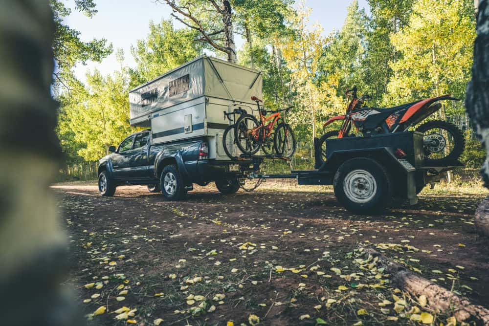 Four Wheel camper pop up truck camper towing bikes