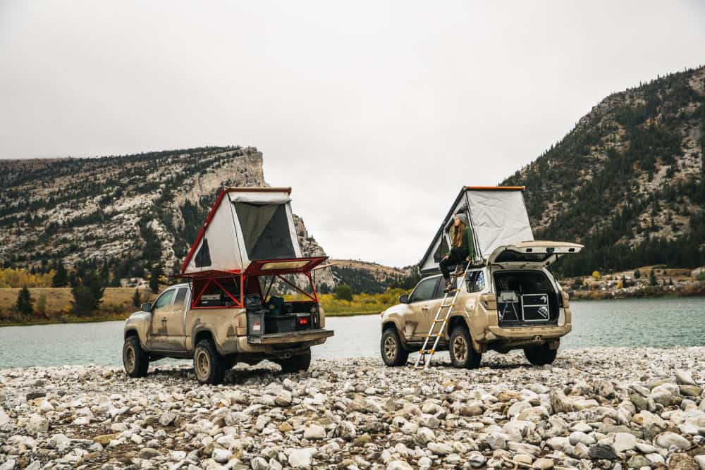 GFC Rooftop Tent on two SUVs near a river