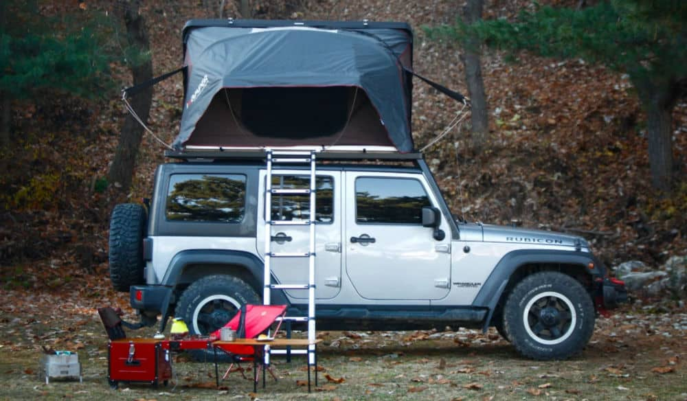 iKamper Skycamp rooftop tent shown on a Jeep in the woods