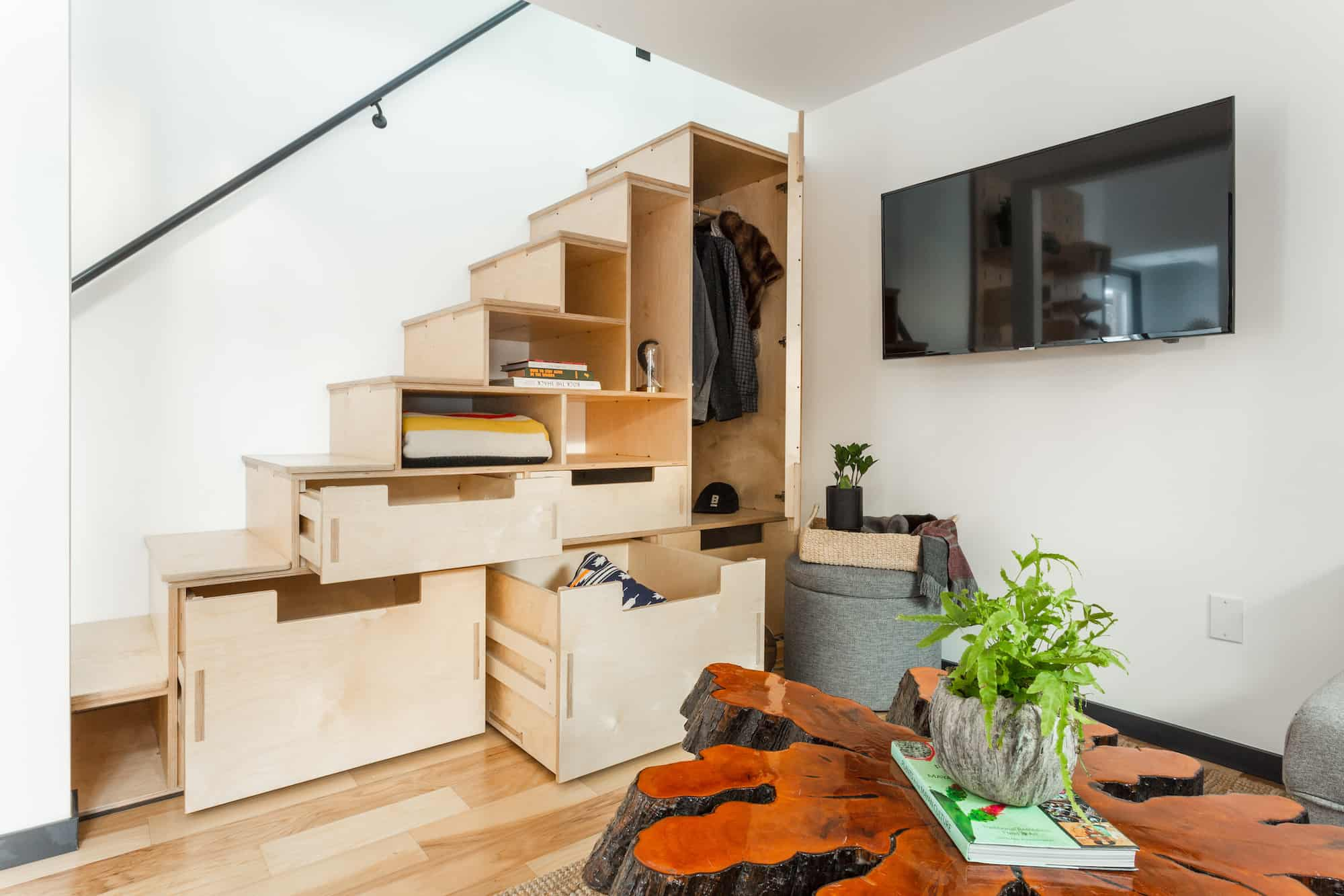 Prefab tiny home staircase storage by Hiatus Home