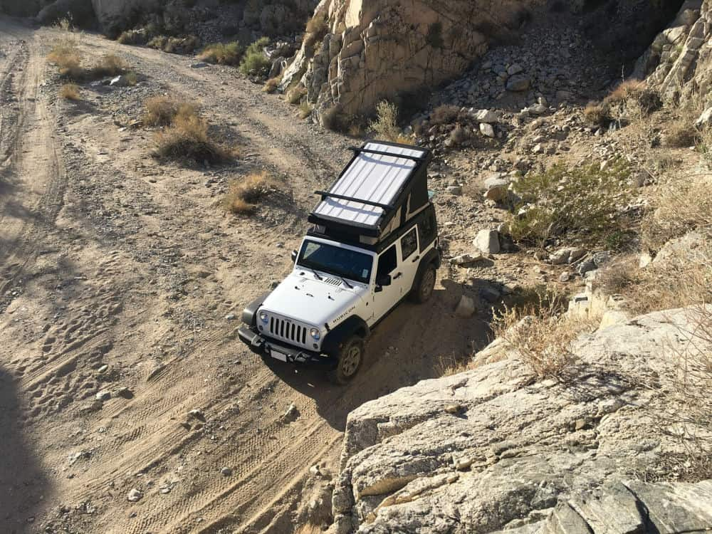 A Jeep Wrangler camper parked in the desert