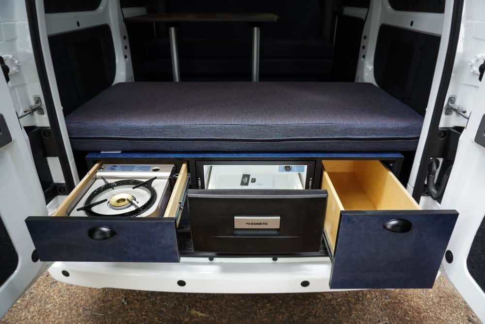 Slide out drawers show storage space and a butane stove