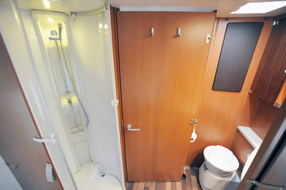 RV dry bathroom with separate shower, toilet and sink