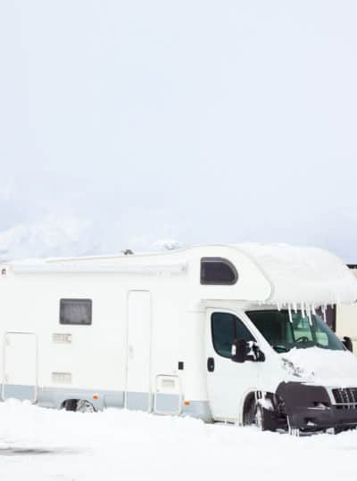 These RVs parked in the snow would do good from an RV wood stove