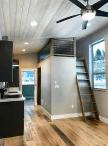 Prefab tiny home interior loft and kitchen by ZipKitHomes