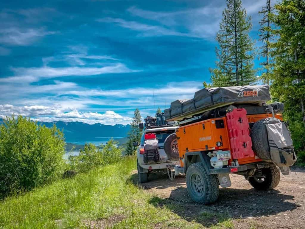 An SUV towing a Turtleback Expedition Trailer, which would also work towed by a Jeep