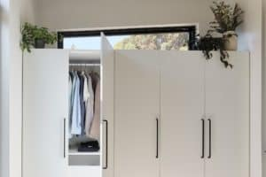 White Scandinavian style closets in prefab tiny house