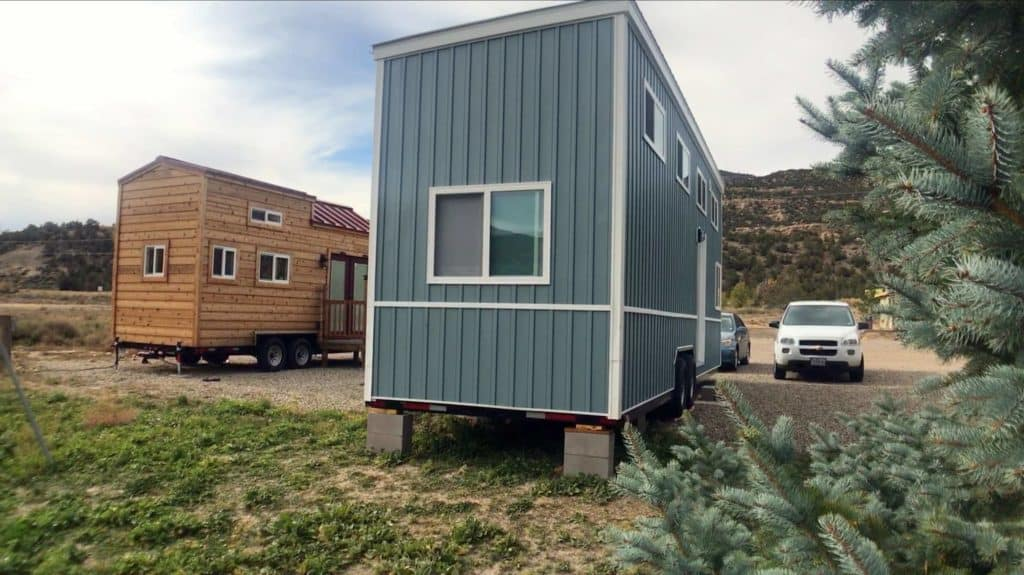 Tiny houses parked near each other at a tiny house community in New Mexico