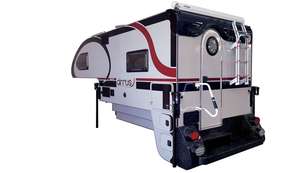 Compact white, red and black truck bed camper made by NuRV. The model of this truck camper is Cirrus 920