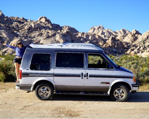 Van Lifer standing on the back of a campervan