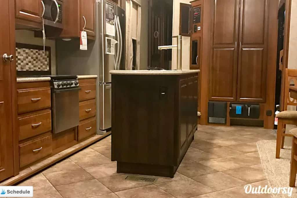 The interior kitchen area of a 5th wheel trailer