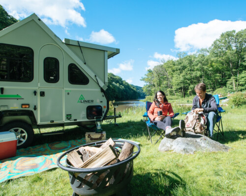 People enjoying the great outdoors with their A-frame camper