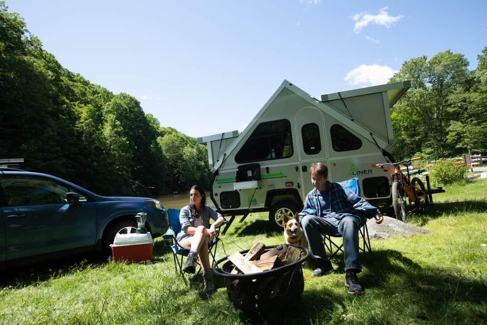 Couple enjoys great outdoors in their A-frame camper