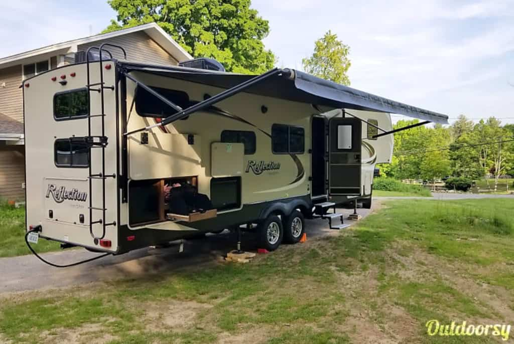 Grand Design camping trailer rental parked in a backyard