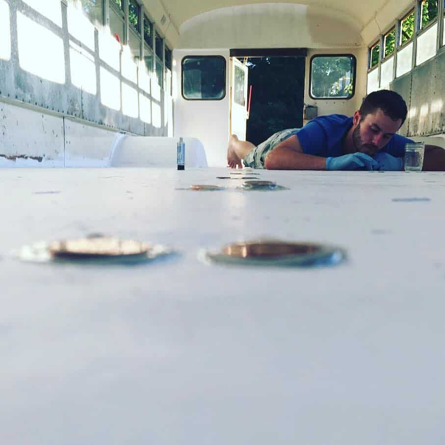 Patching up holes in the school bus camper's floor