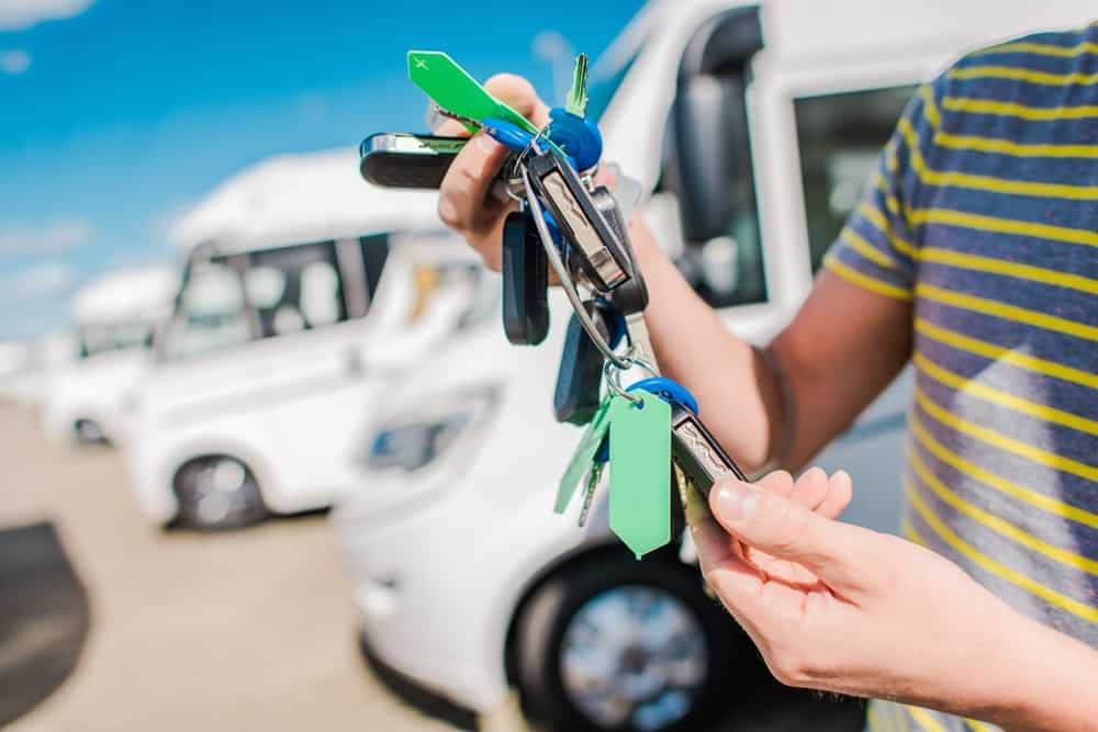 RV dealer handing out keys for an RV loan
