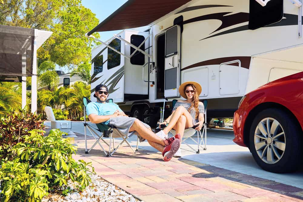 Couple enjoying their new RV after getting an RV loan