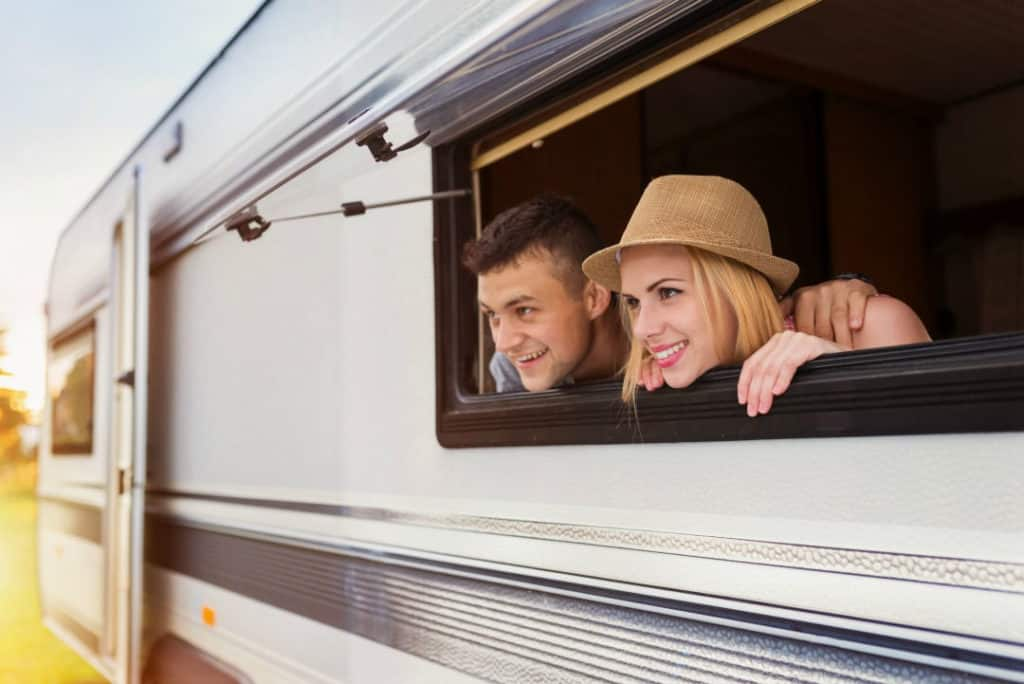 Couple peering out the side window of a new motorhome