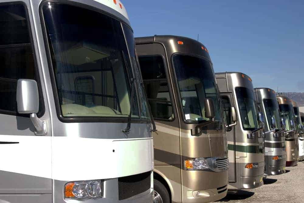 RVs for sale lined up at a dealership