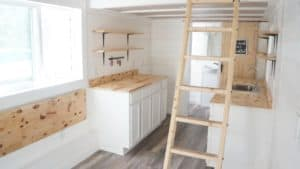 Galley Kitchen with open shelving above