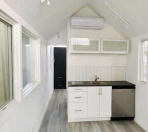 Small kitchen area with glass cabinets over head
